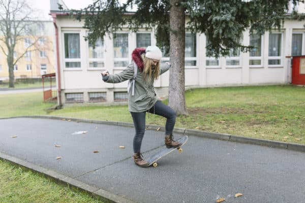 girl on skateboard trying new things