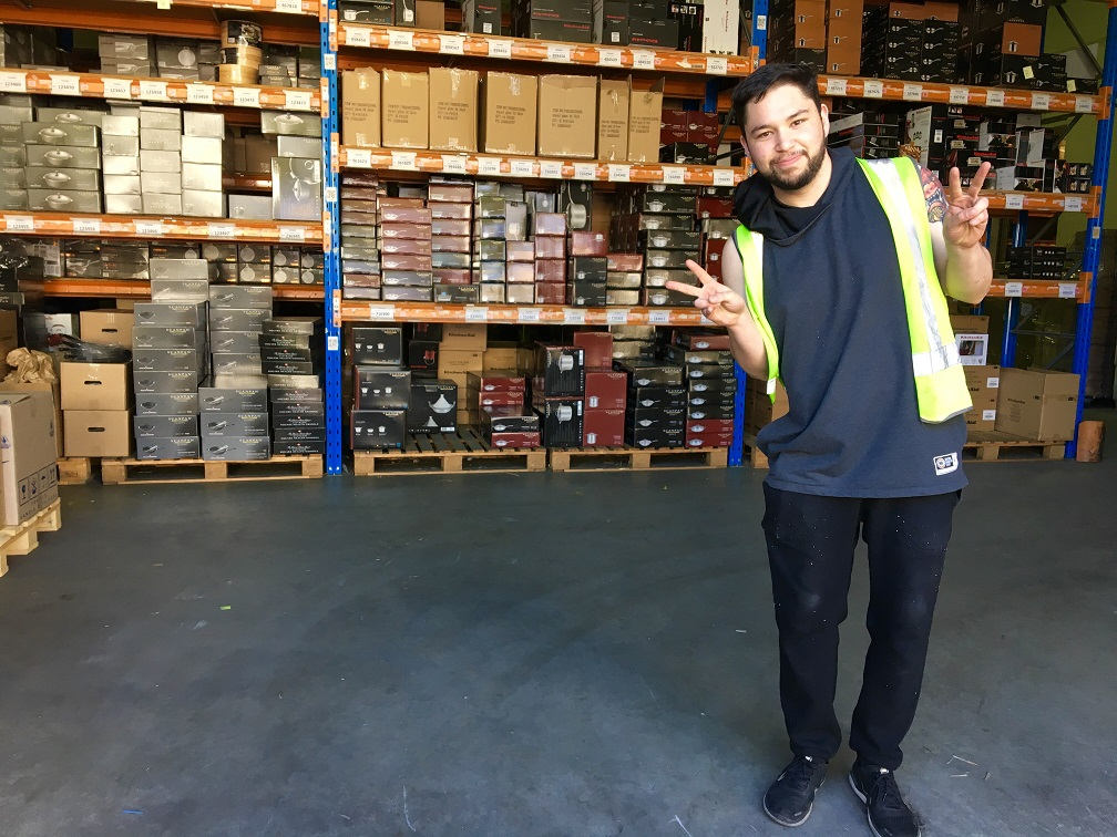 Juan at his new job in Warehouse