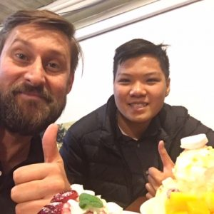 Young person and coach share a celebratory ice cream