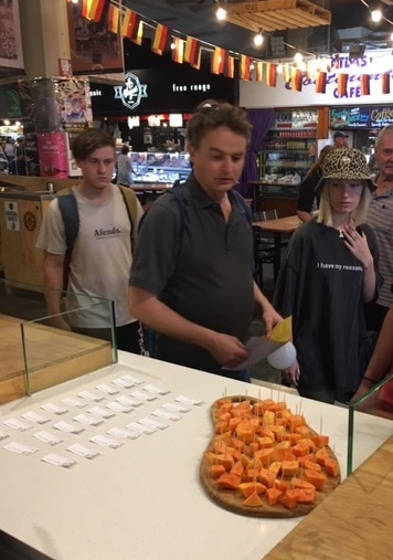 Young people at central market try food samples