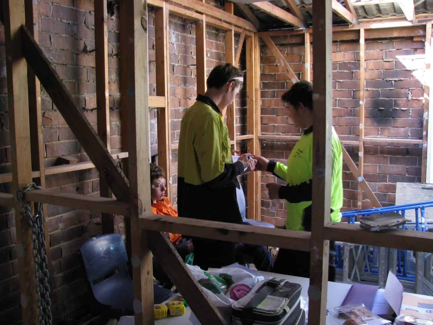 two young people working in construction site