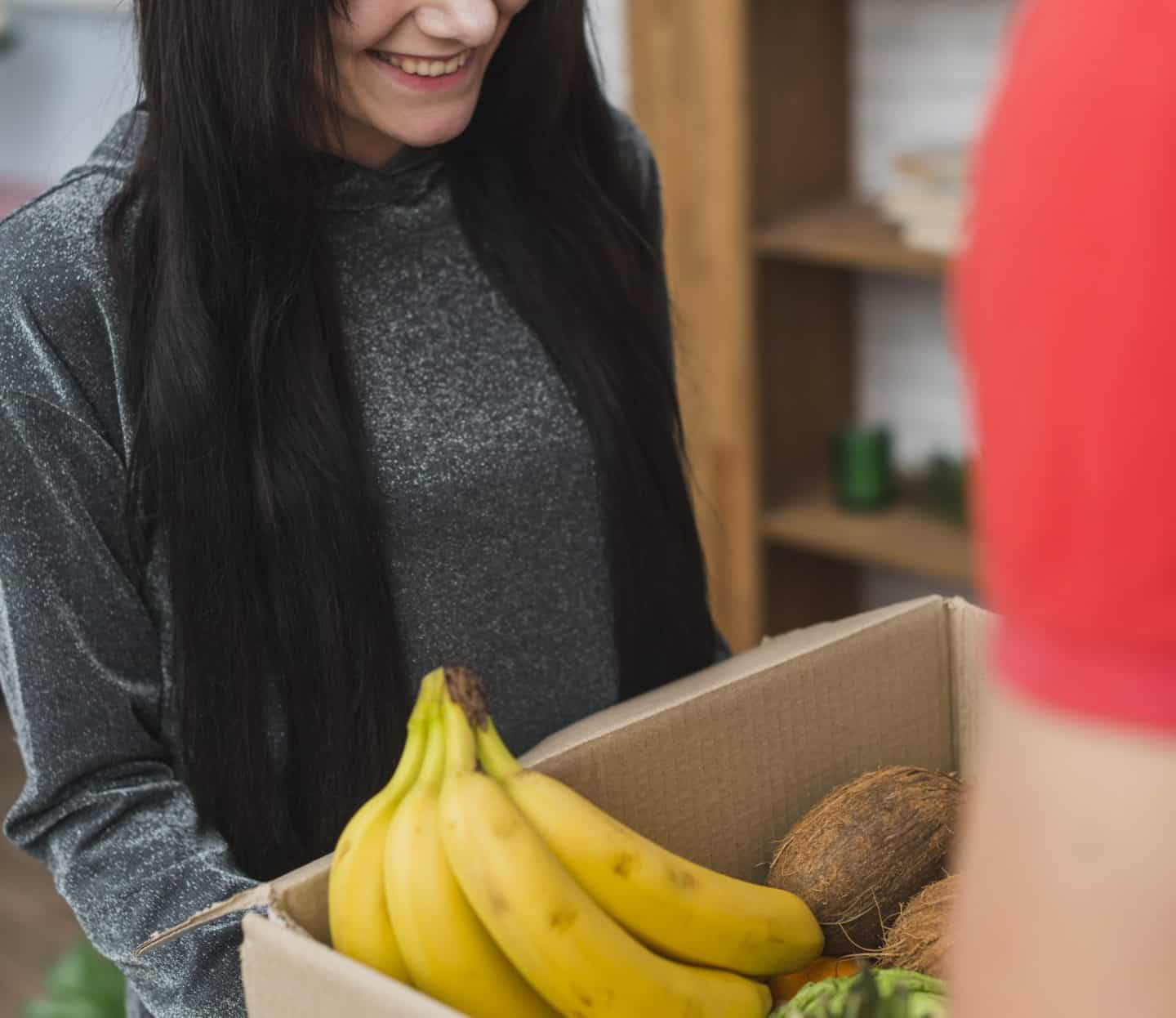 woman receives food box